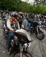 "Michael Jenson and Donna Jengo from North Fort Myers, FL head out from Laconia Harley in Meredith on the ""Ride to the Sky"" with the Winnipesaukee Chapter of Harley Davidson group Thursday morning.  (Karen Bobotas/for the Laconia Daily Sun)"
