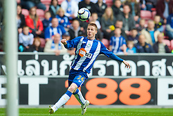 WIGAN, ENGLAND - Monday, May 3, 2010: Wigan Athletic's James McCarthy in action against Hull City during the Premiership match at DW Stadium. (Photo by David Rawcliffe/Propaganda)
