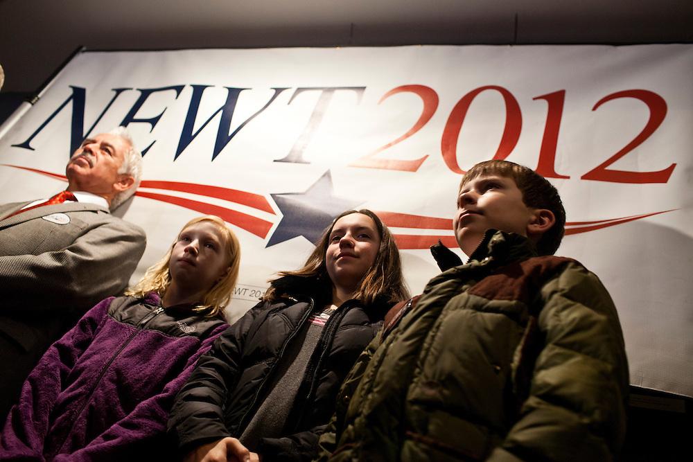 Children listen as Republican presidential candidate Newt Gingrich speaks at Tish's Restaurant on Saturday, December 31, 2011 in Council Bluffs, IA.