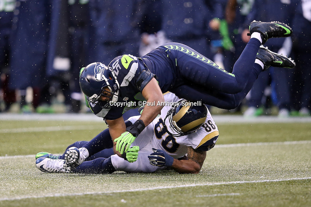 Seattle Seahawks outside linebacker K.J. Wright (50) breaks up a pass intended for St. Louis Rams tight end Lance Kendricks (88) during the 2015 NFL week 16 regular season football game against the St. Louis Rams on Sunday, Dec. 27, 2015 in Seattle. The Rams won the game 23-17. (©Paul Anthony Spinelli)
