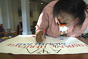 Joi Bailey, Sophomore with the Alpha Psi Lamda co-ed fraturnity makes a poster Thursday afternoon promoting Hispanic Heritage Month at Lindley Cultural Center.  Hispanic Heritage Month begins Sept 15..Johnny Hanson Photo