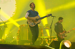 © Licensed to London News Pictures. 15/06/2016.  Coldplay members CHRIS MARTIN and GUY BERRYMAN play at Wembley Stadium during their Handful of Dreams World tour.<br /> <br /> Please note this supplied photo is for editorial usage only and cannot be used for merchandise.  This supplied photo must be deleted and withdraw from usage on 14th September 2016 as agreed by Coldplay management.  London, UK. Photo credit: Ray Tang/LNP