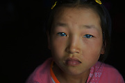 """CHONGQING, CHINA - (CHINA OUT) <br /> <br /> Chinese Blue-eyed Girl In Chongqing<br /> <br /> Blue-eyed girl Chen Guixiu, 11, plays with a dog at home in Tieqiao village in Chongqing, China. Chen Guixiu was born with blue eyes but her skin and hair are the same as other Chinese people. Local villagers always call Chen """"alien"""" behind her back, and Chen Guixiu doesn't have any fellows. Parents found out Chen Guixiu is deaf when she was three. Chen Guixiu got free body check-ups at Nanchuan District People's Hospital on May 3, an eye doctor said that Chen's eyes basic function is normal, but they can't confirm the cause. <br /> ©ChinaFoto/Exclusivepix"""