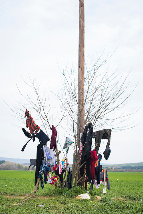 Frequent rains have turned every fence, tree and wire into drying racks for clothes at a refugee camp on the Macedonian (FYROM) border on March 6, 2016 in Idomeni, Greece.