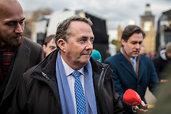 © Licensed to London News Pictures. 12/12/2018. London, UK. Secretary of State for International Trade Liam Fox arrives on College Green to give interviews. Prime Minister Theresa May faces a vote of no confidence from her own party this evening. Photo credit: Rob Pinney/LNP