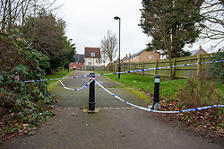© Licensed to London News Pictures. 05/01/2020. Slough, UK. Police tape marks a cordon in Slough at a suspected murder scene, local residents reported that a teenage boy was stabbed on the evening of Saturday 4th January and rushed to Wexham Park hospital where he later died. Photo credit: Peter Manning/LNP