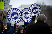 MADISON, WI — FEBRUARY 25: UAW supporters carry signs outside the Wisconsin State Capitol during a rally in opposition to right-to-work legislation.