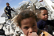 Children are playing in the rubble in the unrecognised Bedouin village of Um Matnan, close to BeerSheva, the capital of the Negev, a large deserted area in the south of Israel. Their house has been demolished together with other four, a month before the picture was taken. The five families now live where they used to keep their camels. Numbering around 200.000 in Israel, the Bedouins constitute the native ethnic group of these areas, they farm, grow wheat, olives and live in complete self sufficiency. Many of them were in these lands long before the Israeli State was created and their traditional lifestyle is now threatened by subtle Governmental policies. The seven Bedouin towns already built are all between the 10 more impoverished towns in Israel..
