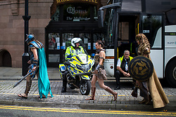 © Licensed to London News Pictures . 30/07/2017 . Manchester , UK . A motorbike policeman watching over the crowds at the venue . Cosplayers, families and guests at Comic Con at the Manchester Central Convention Centre . Photo credit : Joel Goodman/LNP