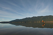 Cyclist on the shore of Lake Quinault - Olympic National Park - Washington State