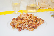 pasta press dish presentation side view from above close-up on white dish