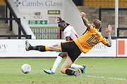 Mohamed Eisa shoots under George Taft to score his 2nd goal during the EFL Sky Bet League 2 match between Cambridge United and Cheltenham Town at the Cambs Glass Stadium, Cambridge, England on 21 April 2018. Picture by Antony Thompson.