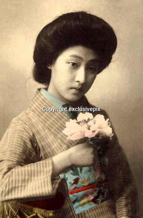 Memories of a geisha: Stunning images reveal the delicate beauty of the woman who enchanted Tokyo 100 years ago<br /> <br /> <br /> The beauty of one of Tokyo's most popular geisha has been preserved in a series of stunning postcards taken more than a century ago. <br /> The collection of images shows Hawaryu, who worked in the Japanese capital at the beginning of the 20th century, posing in a variety of elaborate kimono with her hair pinned in traditional style. <br /> Her porcelain skin and doll-like features have captured the imagination of internet users who have shared the pictures hundreds of times since they were posted. <br /> They were unearthed by an American photographer who lives and works in Japan and posted on his&nbsp;Flickr account under the name Okinawa Soba. <br /> He said the selection were taken in 1910, only a few years before the number of geisha working in the country reached its peak.<br /> It is not known how old Hawaryu is in the series of pictures but her hairstyle suggests she was an apprentice geisha - or maiko - and therefore was probably under 20 years old. <br /> Geisha as a profession emerged in the 18th century and rather than courtesans, women would entertain act as hostesses and entertain male guests with their demure conversation and graceful dance and music skills. <br /> Not much is known about Harwaryu other than the pictures she left behind. <br /> If her marriage was delayed or did not take place then she may have continued working as a geisha for years. <br /> More is known about the photographers, whose initials were left on the images. <br /> One photographer is believed to be Shisui Naruse and the other is thought to be Yoto Tsukamoto. <br /> Okinawa Soba said of the Naruse: 'He obviously considered his portraits to be artistic works, and proudly put his intertwined S N monogram right on the negative.'<br /> The images were printed on mass using the collotype process and the coloured detail would have been hand-painted a