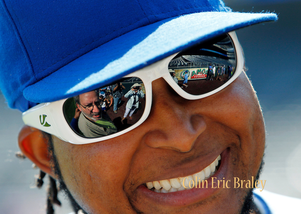 Kansas City Royals pitcher Ervin Santana smiles as he greets a fan during Photo Day for season ticket holders before a baseball game against the Boston Red Sox at Kauffman Stadium in Kansas City, Mo., Sunday, Aug. 11, 2013. (AP Photo/Colin E. Braley)