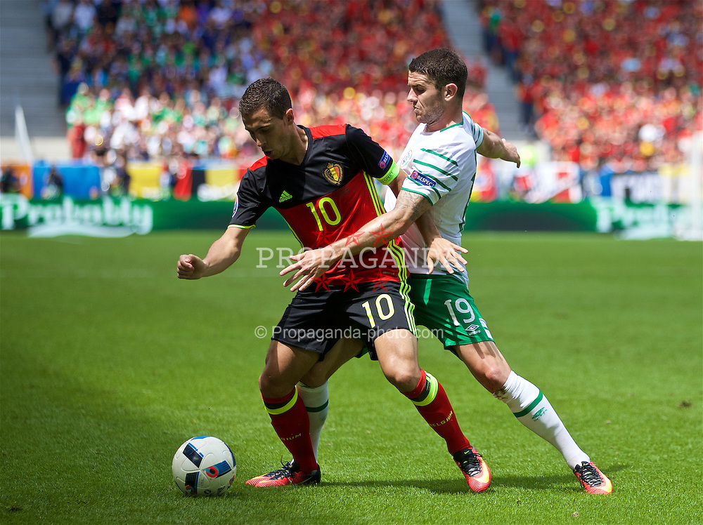 BORDEAUX, FRANCE - Saturday, June 18, 2016: Belgium's Eden Hazard in action against the Republic of Ireland's Robbie Brady during the UEFA Euro 2016 Championship Group E match at Stade de Bordeaux. (Pic by Paul Greenwood/Propaganda)