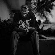 Houston rapper, K-Rino, founder of the legendary South Park Coalition outside of the Kings Best Mart in the third ward of Houston, Texas. © TODD SPOTH