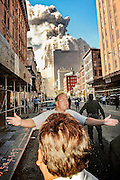 An off duty detective tries to evacuate people from Worth Street and West Broadway as people freeze up watching the WTC North tower collapse.