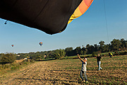 Ground crew guild a hot air balloon for deflation after landing outside the colonial city of San Miguel de Allende, Mexico.