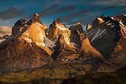 Cuernos del Paine at dawn, above Lago Pehoe, Parque Nacional Torres del Paine, Patagonia, Chile.