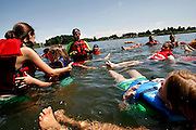 Mark Allen teaches boating and water safety to kids in the Salvation Army Summer Day Camp at Two Rivers Park in Finley, Wash.