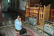 Myanmar Mandalay Hill praying in the Shwenandaw Monastery