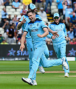 Wicket - Chris Woakes of England celebrates taking the wicket of David Warner of Australia during the ICC Cricket World Cup 2019 semi final match between Australia and England at Edgbaston, Birmingham, United Kingdom on 11 July 2019.