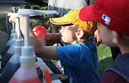 Andrew Hamlett, 5, of Marion helps make a snow cone at the YMCA Adventure Guides booth at the Swamp Fox Festival Picnic In the Park at Marion Square Park in Marion, on Friday, September 9, 2011.