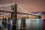 The Brooklyn Bridge as seen from the South Street Sea Port in New York City.