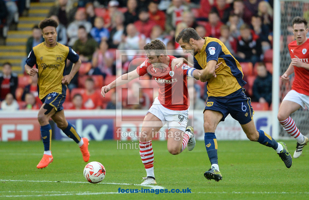 Sam Winnall of Barnsley is pulled back by Gary O&rsquo;Neil of Bristol City during the Sky Bet Championship match at Oakwell, Barnsley<br /> Picture by Richard Land/Focus Images Ltd +44 7713 507003<br /> 29/10/2016