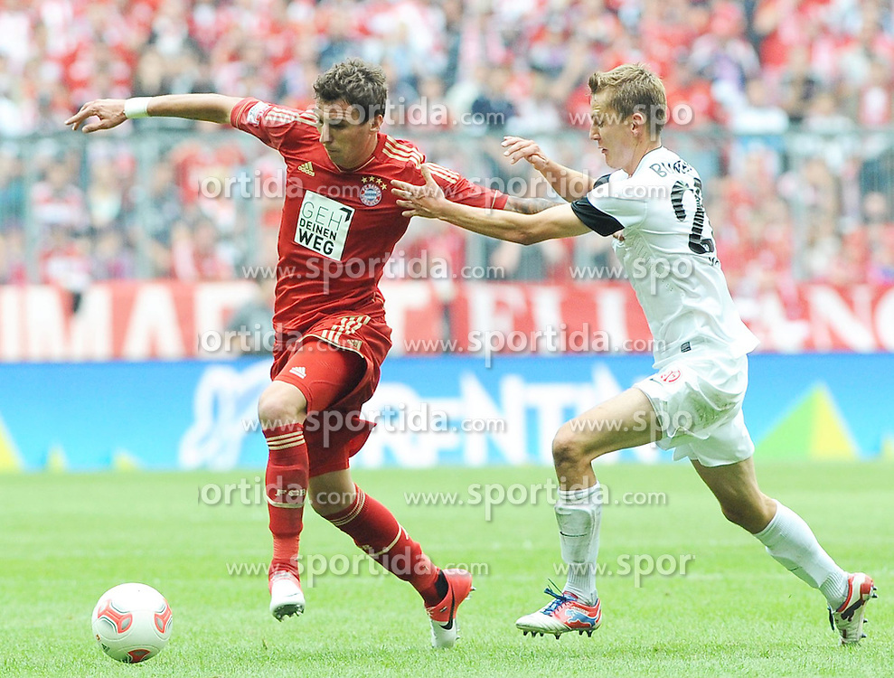 15.09.2012, Allianz Arena, Muenchen, GER, 1. FBL, FC Bayern Muenchen vs 1. FSV Mainz 05, 03. Runde, im Bild Mario MANDZUKIC (FC Bayern Muenchen) und Niko BUNGERT (1.FSV Mainz 05) rechts im Bild. // during the German Bundesliga 03rd round match between FC Bayern Munich and 1. FSV Mainz 05 at the Allianz Arena, Munich, Germany on 2012/09/15,, , , , . EXPA Pictures © 2012, PhotoCredit: EXPA/ Eibner/ Wolfgang Stuetzle..***** ATTENTION - OUT OF GER *****