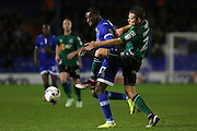 Freddie Ladapo of Oldham Athletic battles with Scunthorpe United defender Conor Townsend (22)  during the EFL Sky Bet League 1 match between Oldham Athletic and Scunthorpe United at Boundary Park, Oldham, England on 18 October 2016. Photo by Simon Brady.