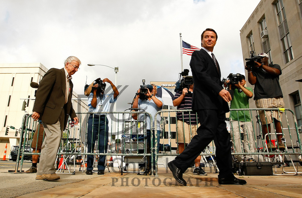 Former U.S. Senator John Edwards arrives with his father Wallace (L) at the federal court house in Greensboro, North Carolina May 29, 2012. Tuesday is the seventh day of jury deliberations about whether Edwards broke federal campaign finance laws as he tried to conceal an affair while running for president in 2008. REUTERS/Chris Keane (UNITED STATES)