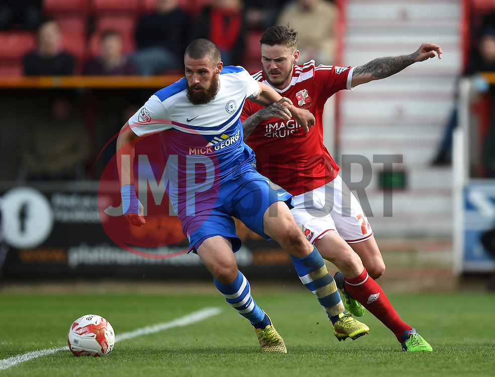 Swindon Town's Ben Gladwin battles with Peterborough United's Michael Bostwick - Photo mandatory by-line: Paul Knight/JMP - Mobile: 07966 386802 - 11/04/2015 - SPORT - Football - Swindon - The County Ground - Swindon Town v Peterborough United - Sky Bet League One