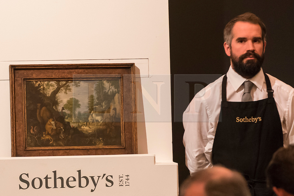 """© Licensed to London News Pictures. 07/12/2016. London, UK. """"Orpheus charming the animals"""" by Roelandt Savery which sold for a hammer price of GBP370k  (est. GBP80-120k), at the Old Masters Evening Sale at Sotheby's in New Bond Street. Photo credit : Stephen Chung/LNP"""