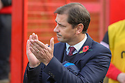 York City Manager Jackie McNamara applauds the fans  during the The FA Cup match between Accrington Stanley and York City at the Fraser Eagle Stadium, Accrington, England on 7 November 2015. Photo by Simon Davies.