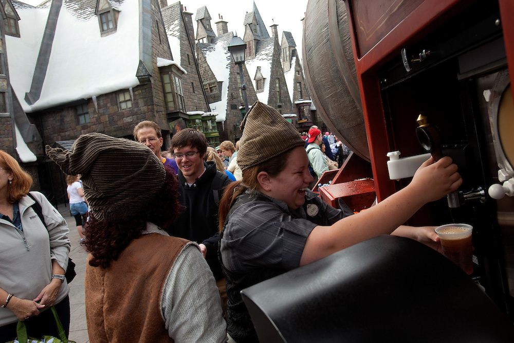 ORLANDO, FL -- January 5, 2011 -- Butterbeer, a non-alcoholic drink with the taste of shortbread and butterscotch, is served up at The Wizarding World of Harry Potter at Universal Orlando in Orlando, Fl., January 5.  The 20-acre park features a new ride inside the Hogwarts Castle and shops along the village of Hogsmeade - which has been packed with fans since its opening in June.