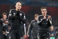 19-02-2013 VOETBAL: CHAMPIONS LEAGUE FC ARSENAL - FC BAYERN MUNCHEN: LONDEN<br /> Arjen ROBBEN (FC Bayern Muenchen - 10) und Philipp LAHM (FC Bayern Muenchen - 21) bedanken sich bei den Fans - applaudieren during the UEFA Champions League last sixteen first leg match between Arsenal FC and FC Bayern Munich at the Emirates Stadium<br /> ***NETHERLANDS ONLY***<br /> ©2012-FotoHoogendoorn.nl