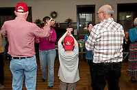 Friends gathered at the Wicwas Grange in Meredith Center on Saturday evening for a old fashioned hoe down with caller Ralph Peacock giving them a foot stompin' good time.   (Karen Bobotas/for the Laconia Daily Sun)