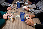 """MONTICELLO, IA – JANUARY 6: Diners at the """"Liberal table"""" discuss political opinions at Darrell's in Monticello, Iowa on January 6, 2017."""