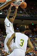 Devonte Robinson (20) of Dallas Madison dunks the ball against Houston Yates during the UIL 3A state championship game at the Frank Erwin Center in Austin on Saturday, March 9, 2013. (Cooper Neill/The Dallas Morning News)