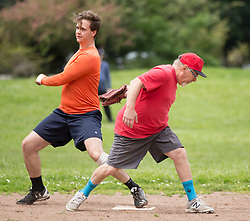 David Ross, right, puts the tag on Ian Acredolo too late as the Montclair softball league celebrates its 50th season, Saturday, April 22, 2017, at Montclair Park in Oakland, Calif. The pickup softball game, played every Saturday by a group of enthusiasts ranging in age from 20 to 75, started in 1968 in Berkeley and moved to Montclair about 25 years ago. (Photo by D. Ross Cameron)