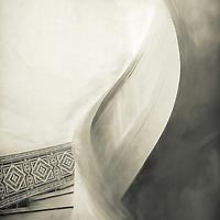 Sculptural curves of spiral stairway in historic urban building, Atlanta.