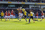 Oxford United's Cheyenne Dunkley(33) jumps to head his team level, 2-2 during the Sky Bet League 2 match between Oxford United and Luton Town at the Kassam Stadium, Oxford, England on 16 April 2016. Photo by Shane Healey.