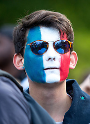 © Licensed to London News Pictures. 10/07/2016. London, UK. Fans watch the first half of UEFA Euro 2016 Final at the big screen at Pop Football Kennington, run by Six Yard Box, where Euro 2016 hosts France play Portugal. The score at half-time is 0-0. Photo credit : Tom Nicholson/LNP