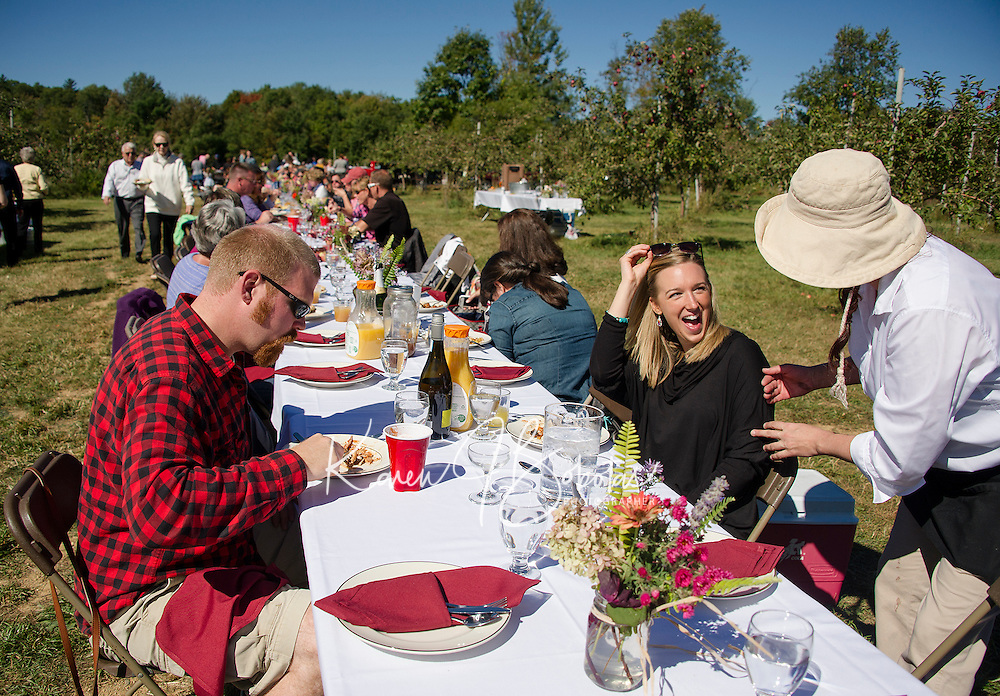 "Ted Jones, Whitney Vachon are greeted by Amara Hartshorn during ""Breakfast in the Orchard"" with Chef Kevin Halligan Local Eatery held at Smith Orchard in Belmont on Sunday.  (Karen Bobotas/for the Laconia Daily Sun)"
