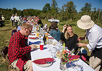 """Ted Jones, Whitney Vachon are greeted by Amara Hartshorn during """"Breakfast in the Orchard"""" with Chef Kevin Halligan Local Eatery held at Smith Orchard in Belmont on Sunday.  (Karen Bobotas/for the Laconia Daily Sun)"""