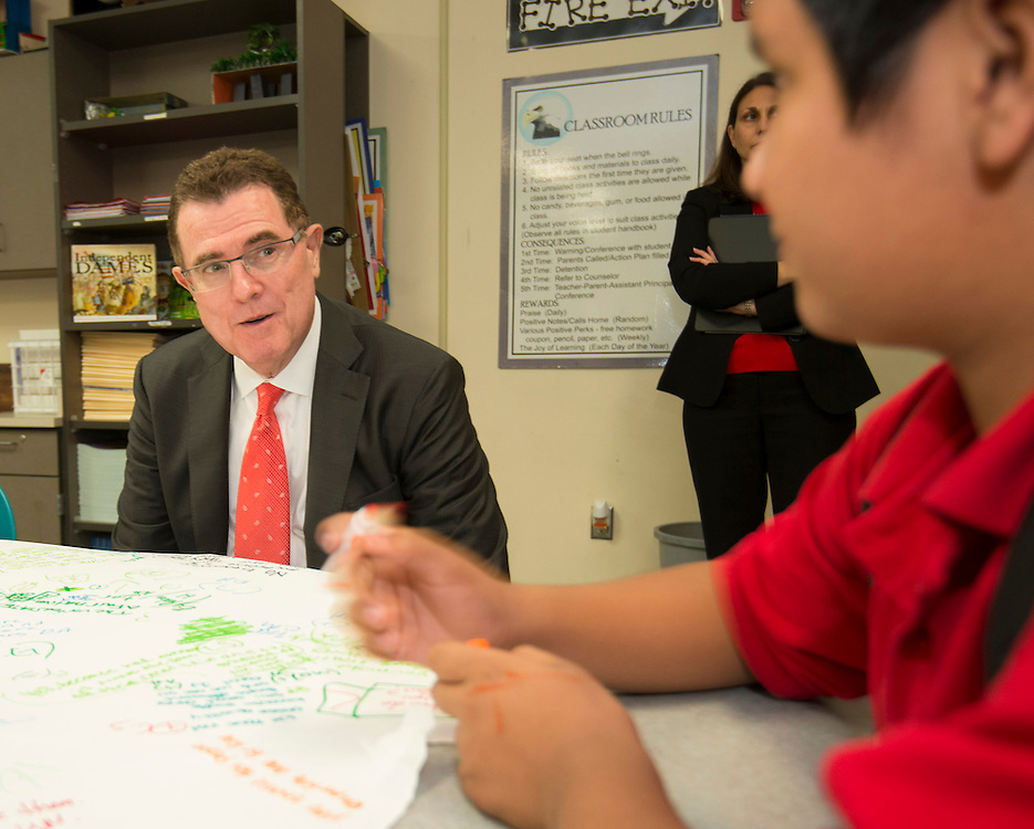 Houston ISD superintendent Dr. Terry Grier, left, talks with students during a Broad Foundation research team tour Ortiz Middle School, May 29, 2013.