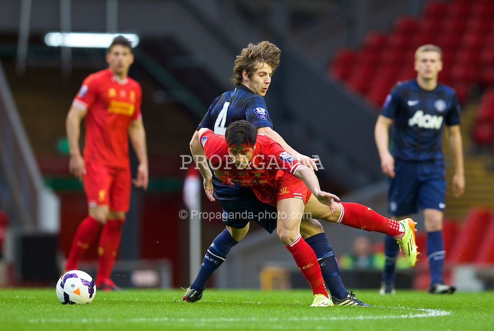 ANFIELD, ENGLAND - Friday, May 2, 2014: Liverpool's Joao Carlos Teixeira in action against Manchester United's Ben Pearson during the Under 21 FA Premier League Semi-Final match at Anfield. (Pic by David Rawcliffe/Propaganda)