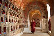 Monks in Buddhist temple, Mandalay, Burma