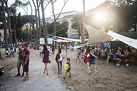 "ROME, ITALY - 3 JULY 2016: Visitors gather at the Ponte Nomentano park which hosts the iFest, an alternative music festival, where the Gipsy Queens have a food stand, in Rome, Italy, on July 3rd 2016.<br /> <br /> The Gipsy Queens are a travelling catering business founded by Roma women in Rome.<br /> <br /> In 2015 Arci Solidarietà, an independent association for the promotion of social development, launched the ""Tavolo delle donne rom"" (Round table of Roma women) to both incentivise the process of integration of Roma in the city of Rome and to strengthen the Roma women's self-esteem in the context of a culture tied to patriarchal models. The ""Gipsy Queens"" project was founded by ten Roma women in July 2015 after an event organised together with Arci Solidarietà in the Candoni Roma camp in the Magliana, a neighbourhood in the South-West periphery of Rome, during which people were invited to dance and eat Roma cuisine. The goal of the Gipsy Queen travelling catering business is to support equal opportunities and female entrepreneurship among Roma women, who are often relegated to the roles of wives and mothers."